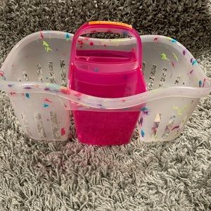 Pink and clear plastic shower caddy